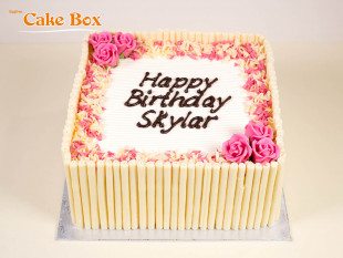 White Chocolate Cigarillo Birthday Cake with Pink Flowers